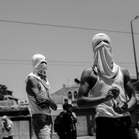Palestinian youth preparing to clash with the Israeli forces